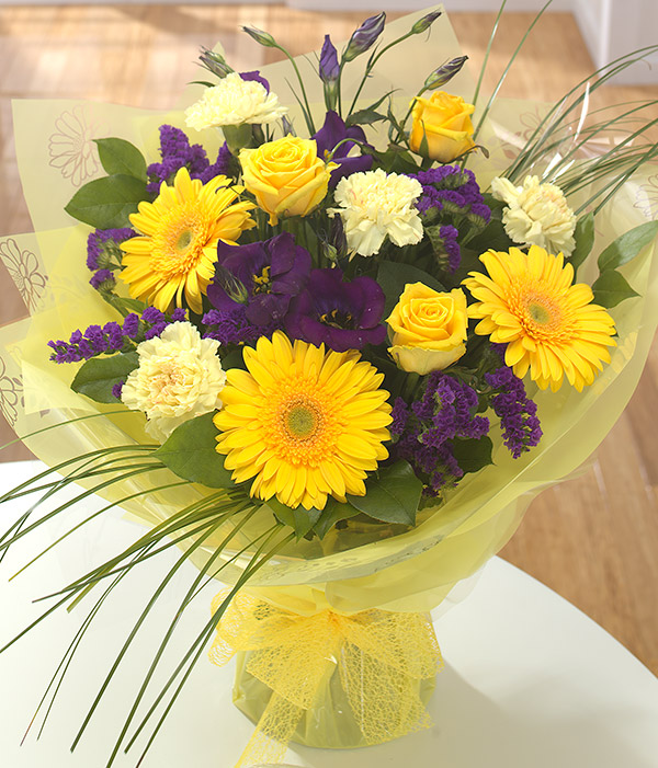 bold yellow gerbera and lisianthus stocks statice