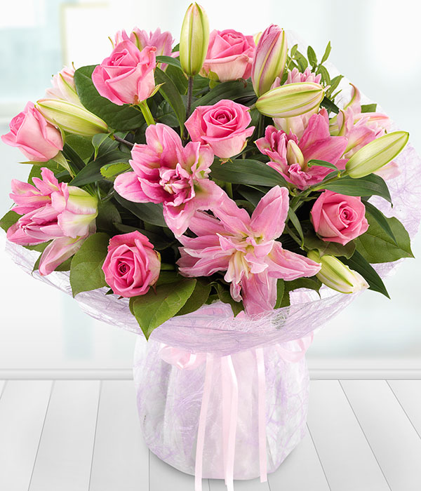 elegant pink rose and lily bouquet presented beaut