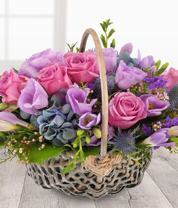 blue and purple lilac flowers delivered in a baske
