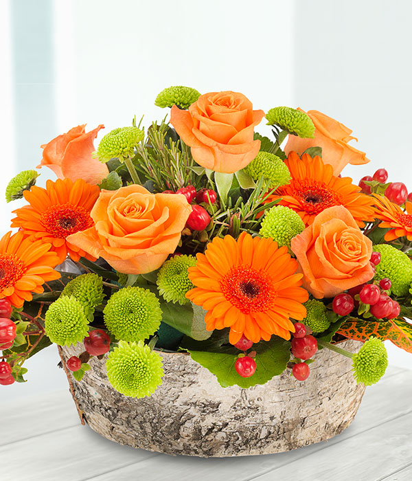 orange flower container arrangement delivered by f
